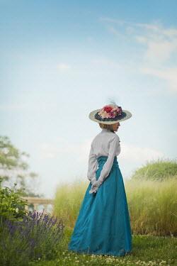 Ildiko Neer Victorian woman standing in garden with hat Women