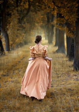 Jaroslaw Blaminsky HISTORICAL WOMAN WALKING IN AVENUE OF TREES Women