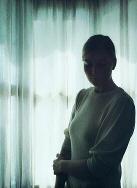 Mark Owen BLONDE WOMAN STANDING INDOORS BY WINDOW Women