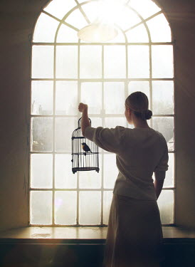 Mark Owen WOMAN AT WINDOW WITH BIRD IN CAGE Women