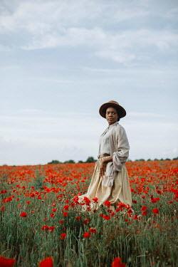 Shelley Richmond SERIOUS BLACK WOMAN WITH HAT IN POPPY FIELD Women