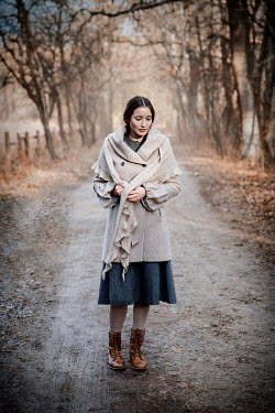 Natasza Fiedotjew Young vintage woman standing on road in woods