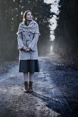 Natasza Fiedotjew Vintage woman standing on road in woods