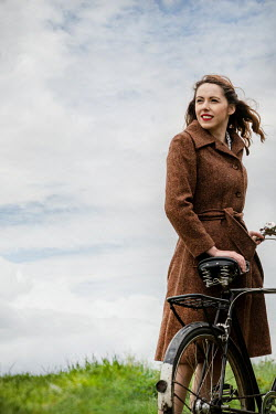 CollaborationJS WOMAN IN COAT WITH BIKE IN COUNTRYSIDE Women