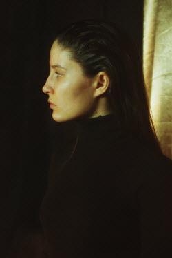 Daria Amaranth SERIOUS WOMAN WITH DARK HAIR IN PROFILE Women