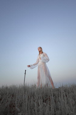 Inna Mosina BLONDE WOMAN WITH SWORD IN FIELD Women