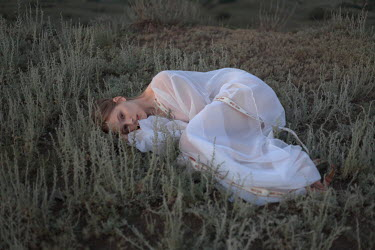 Inna Mosina WOMAN IN WHITE LYING IN COUNTRYSIDE Women