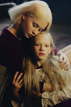 Irina Orwald BLONDE WOMAN HUGGING YOUNG GIRL INDOORS Women