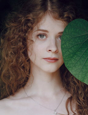 Irina Orwald WOMAN WITH CURLY BROWN HAIR AND LEAF Women