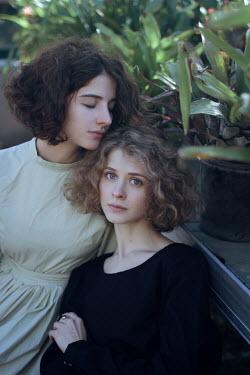 Irina Orwald TWO DREAMY GIRLS SITTING IN GARDEN Women