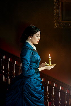 Lee Avison victorian woman holding a candle at night