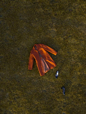 Mary Wethey ORANGE COAT AND BLACK SHOES LYING ON GRASS Miscellaneous Objects