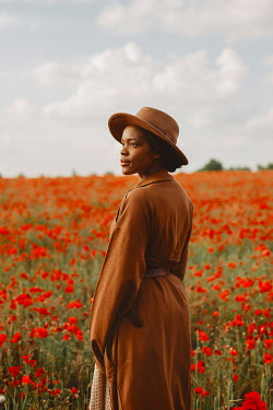 Shelley Richmond BLACK WOMAN IN HAT STANDING IN POPPY FIELD Women