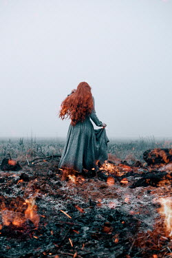 Rekha Garton WOMAN WITH BURNING RED HAIR IN FIELD OF FIRE Women