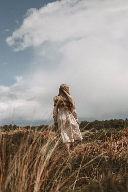 Shelley Richmond BLONDE GIRL IN DRESS STANDING IN COUNTRYSIDE Women