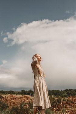 Shelley Richmond BLONDE GIRL IN DRESS DAYDREAMING IN COUNTRYSIDE Women