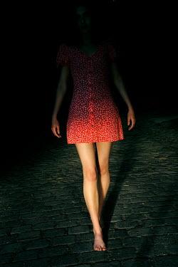 Ute Klaphake WOMAN WALKING BAREFOOT ON STREET AT NIGHT Women