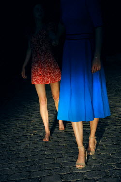 Ute Klaphake TWO WOMEN WALKING ON COBBLED STREET AT NIGHT Women