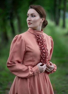 Jaroslaw Blaminsky WOMAN IN PINK DRESS IN COUNTRYSIDE Women