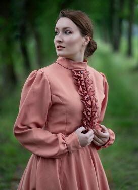 Jaroslaw Blaminsky WOMAN IN PINK DRESS IN COUNTRYSIDE Women