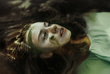 Kirill Sakryukin WOMAN WITH ALGAE ON FACE FLOATING IN RIVER Women