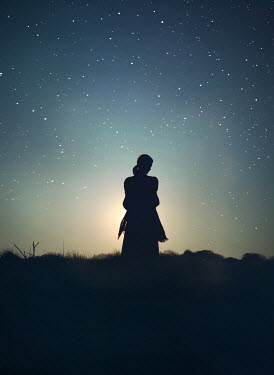 Mark Owen SILHOUETTED WOMAN IN COUNTRYSIDE WITH STARRY SKY Women