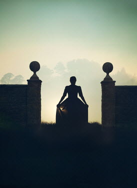 Mark Owen SILHOUETTED WOMAN STANDING BETWEEN GATE POSTS Women