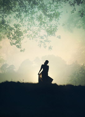 Mark Owen SILHOUETTED WOMAN IN COUNTRYSIDE WITH TREES Women
