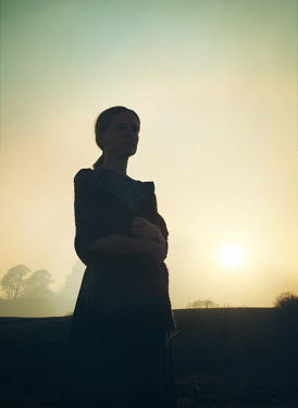 Mark Owen WOMAN IN SHADOW IN COUNTRYSIDE AT SUNSET Women