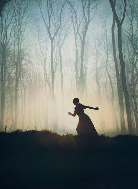 Mark Owen SILHOUETTED WOMAN RUNNING IN FOREST AT DUSK Women