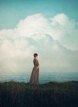 Mark Owen WOMAN STANDING WATCHING SEA WITH CLOUDS Women