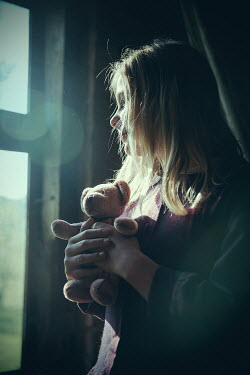 Natasza Fiedotjew Girl by the window holding teddy bear