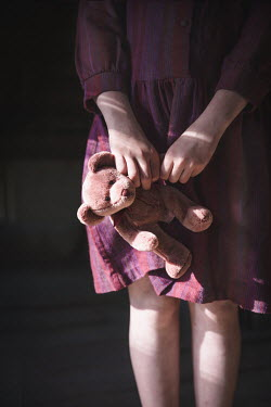 Natasza Fiedotjew Girl in vintage dress holding teddy bear