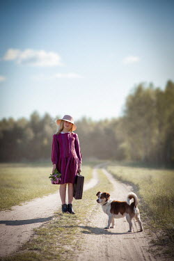 Natasza Fiedotjew GIRL CARRYING SUITCASE WITH DOG IN COUNTRYSIDE Children