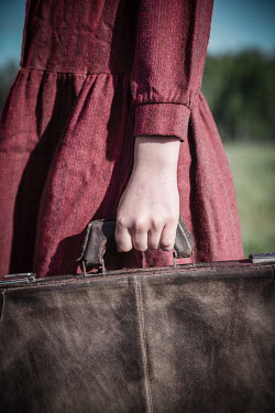 Natasza Fiedotjew Close up of vintage girl holding suitcase