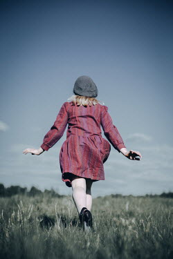 Natasza Fiedotjew Vintage girl running away in field