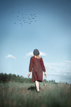 Natasza Fiedotjew Vintage girl walking away in fields
