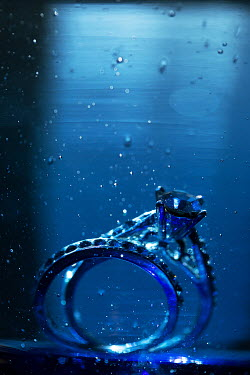 Alison Archinuk WEDDING AND ENGAGEMENT RING UNDERWATER WITH BUBBLES Miscellaneous Objects