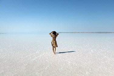 Esmahan Ozkan WOMAN WALKING ON SALT FLATS Women