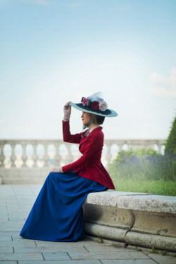 Ildiko Neer Victorian woman sitting on terrace