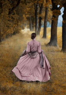 Jaroslaw Blaminsky WOMAN IN PINK GOWN IN AUTUMN COUNTRYSIDE Women