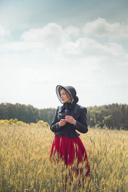 Joanna Czogala WOMAN WITH BONNET IN SUMMERY WHEAT FIELD Women