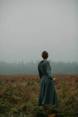 Rekha Garton BLONDE WOMAN STANDING IN WINTRY COUNTRYSIDE Women