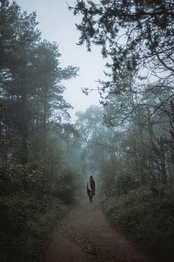 Shelley Richmond WOMAN IN COAT WALKING ON COUNTRY PATH Women