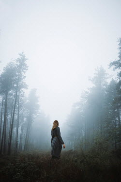 Shelley Richmond BLONDE WOMAN STANDING IN FOGGY FOREST Women