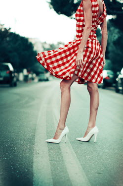 Irene Lamprakou WOMAN WITH SHORT DRESS AND HIGH HEELS IN STREET Women