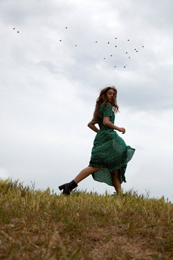 Miguel Sobreira Retro Woman Running Through Field