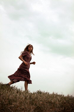 Miguel Sobreira Retro Woman Running on Grass