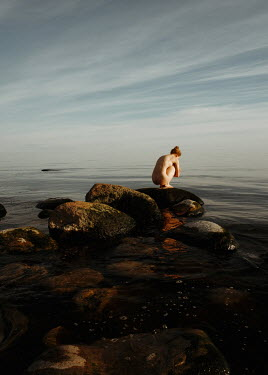 Daniil Kontorovich NAKED WOMAN CROUCHING ON ROCK BY SEA Women