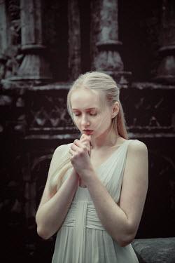 Nic Skerten BLONDE GIRL PRAYING OUTSIDE BUILDING Women